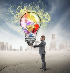 Businessman with creative business idea in hand